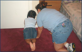 Graphic showing a child and  an adult crawling on the floor